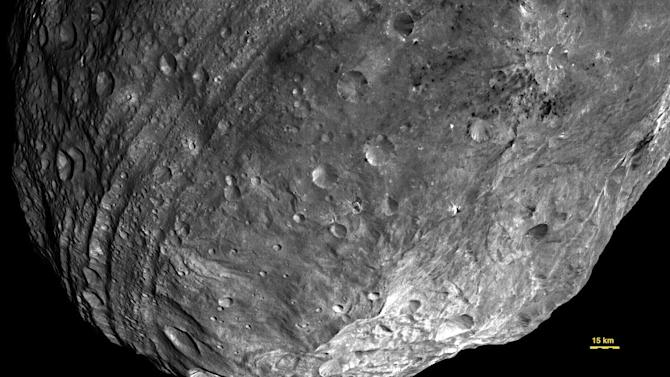 This July 23, 2011 image of the Asteroid Vesta, released by NASA/JPL, was captured by the Dawn spacecraft at a distance of 3,200 miles (5,200 kilometers).  Dawn entered orbit around Vesta on July 15, and will spend a year orbiting the body. After that, the next stop on its itinerary will be an encounter with the dwarf planet Ceres. (AP Photo/ NASA/JPL)
