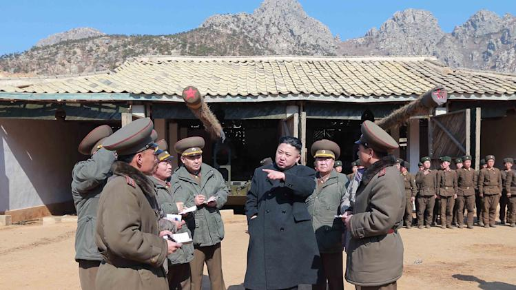 "In this March 11, 2013 photo released by the Korean Central News Agency (KCNA) and distributed March 12, 2013 by the Korea News Service, North Korean leader Kim Jong Un, center, confers with military officers at a long-range artillery sub-unit of KPA Unit 641 during his visit to front-line military units near the western sea border in North Korea near the South's western border island of Baengnyeong. Kim urged front-line troops to be on ""maximum alert"" for a potential war as a state-run newspaper said Pyongyang had carried out a threat to cancel the 1953 armistice that ended the Korean War.  (AP Photo/KCNA via KNS) JAPAN OUT UNTIL 14 DAYS AFTER THE DAY OF TRANSMISSION"