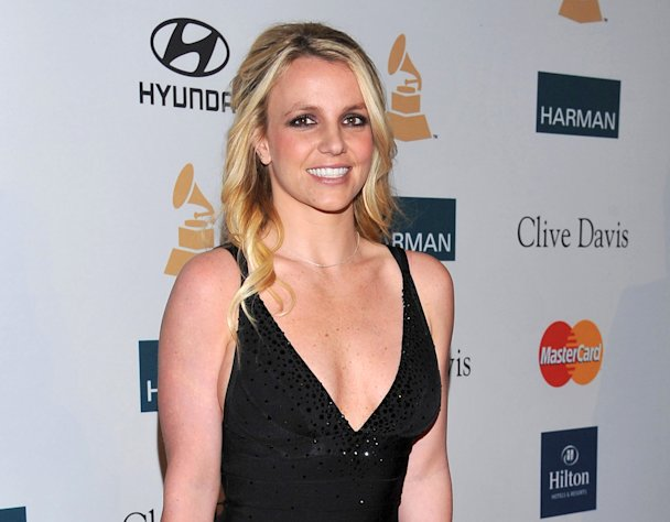 "FILE - In this Feb. 11, 2012 file photo, singer Britney Spears arrives at the Pre-GRAMMY Gala & Salute to Industry Icons with Clive Davis honoring Richard Branson in Beverly Hills, Calif. Spears is a judge on ""The X Factor."" Fox's ""The X Factor"" began airing live episodes Wednesday, Oct. 31, 2012, with new co-hosts Khloe Kardashian and Mario Lopez. (AP Photo/Vince Bucci, file)"
