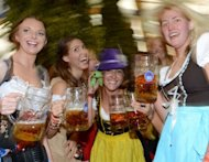 Young women celebrate Oktoberfest in Munich on September 22. The world&#39;s largest beer festival opened with a pop Saturday as the first keg was tapped at Munich&#39;s Oktoberfest, a 16-day extravaganza of lederhosen, oompah music and millions of ales