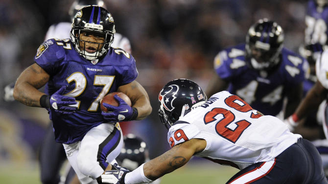 Baltimore Ravens running back Ray Rice, left, attempts to rush past Houston Texans safety Glover Quin in the second half of an NFL football game in Baltimore, Sunday, Oct. 16, 2011. Baltimore won 29-14. (AP Photo/Nick Wass)