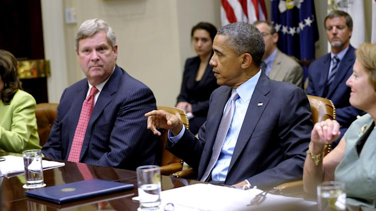 President Barack Obama holds a meeting on the ongoing efforts on the drought during a meeting of the White House Rural Council in the Roosevelt Room at the White House in Washington, Tuesday, Aug. 7, 2012. From left are, Labor Secretary Hilda Solis, Agriculture Secretary Tom Vilsack, the president and Small Business Administration Administrator Karen Mills.  (AP Photo/Susan Walsh)