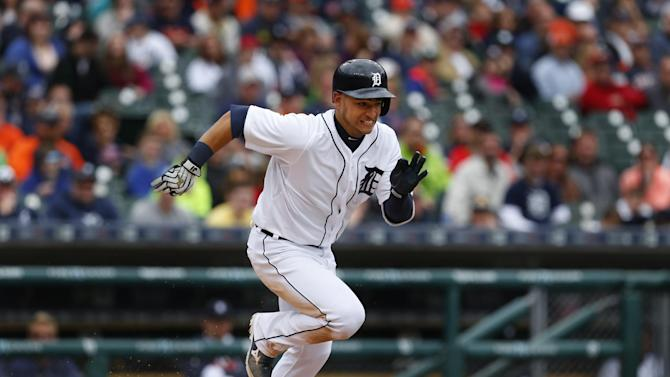 Detroit Tigers' Jose Iglesias runs out a bunt against the Cleveland Indians in the eighth inning of a baseball game in Detroit Sunday, April 26, 2015. (AP Photo/Paul Sancya)