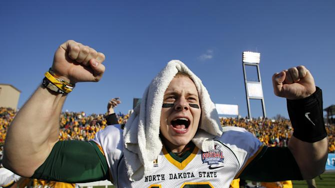 North Dakota State's Brock Jensen (16) celebrates at the end of the FCS Championship NCAA college football game against Sam Houston State, Saturday, Jan. 5, 2013, in Frisco, Texas. Jensen was awarded the game's most valuable player trophy in their 39-13 win.  (AP Photo/Tony Gutierrez)