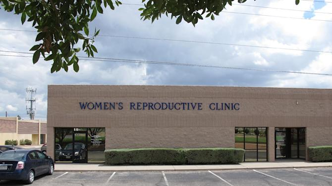The Women's Reproductive clinic is seen in Santa Teresa, New Mexico, Monday, Aug. 11, 2014. If the new abortion law, one of the toughest in the nation, is upheld by a federal judge, the only remaininc abortion clinic in El Paso, across the state border from Santa Teresa, will be forced to close due to new requirements and women will have to travel hundreds of miles or go to New Mexico to obtain an abortion. (AP Photo/Juan Carlos Llorca)