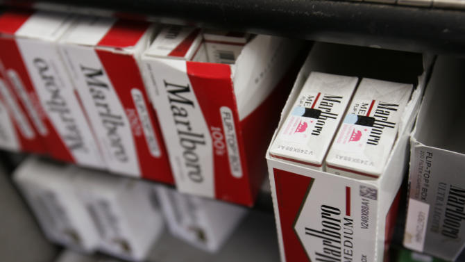 FILE - In this Wednesday, Feb. 4, 2013, photo, Philip Morris' Marlboro cigarettes on display at a market in Palo Alto, Calif .Philip Morris International Inc. reports quarterly financial results before the market opens on Thursday, April 18, 2013. (AP Photo/Paul Sakuma, File)