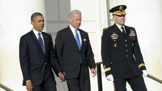 FILE - In this Jan. 20, 2013, file photo, President Barack Obama and Vice President Joe Biden, accompanied by then-Maj. Gen. Michael S. Linnington, Commander of the U.S. Army Military District of Washington, arrive to place a wreath at the Tomb of the Unknowns at Arlington National Cemetery in Arlington, Va. Linnington, the Pentagon's new leader of the search for military members missing from past wars says he will push for more partnerships with private groups that have resources and interest in the MIA accounting mission.   (AP Photo/Susan Walsh, File)