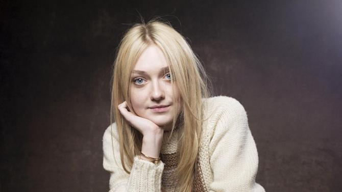 """Dakota Fanning from the film """"Very Good Girls"""" poses for a portrait during the 2013 Sundance Film Festival at the Fender Music Lodge, on Tuesday Jan. 22, 2013 in Park City, Utah. (Photo by Victoria Will/Invision/AP Images)"""