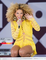 FILE - In this July 1, 2011 file photo, Beyonce performs on ABC&#39;s &quot;Good Morning America&quot; in New York. Through a photo contest, 100 fans will join Beyonce onstage during the singers halftime show performance at the 2013 Super Bowl on Feb. 3, 2013, at the Mercedes-Benz Superdome in New Orleans. (AP Photo/Charles Sykes, File)