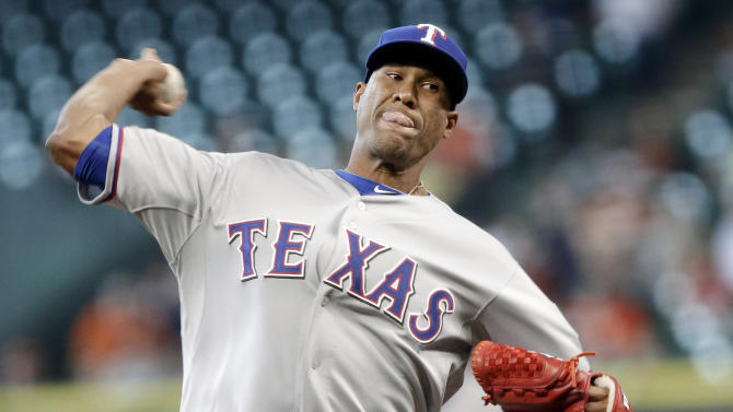 Texas Rangers' Alexi Ogando delivers a pitch against the Houston Astros during the first inning of a baseball game, Wednesday, April 3, 2013, in Houston. (AP Photo/Pat Sullivan)