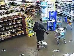 Still frame from video shows a gunman aims his rifle inside a store during an attack on the Westgate shopping mall