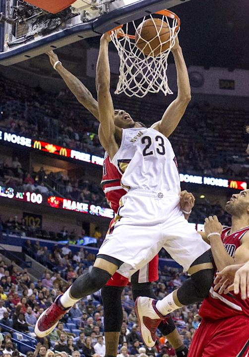 New Orleans Pelicans forward Anthony Davis (23) dunks against the Portland Trail Blazers in the second half of an NBA basketball game in New Orleans, Friday, March 14, 2014. The Trail Blazers won 111-