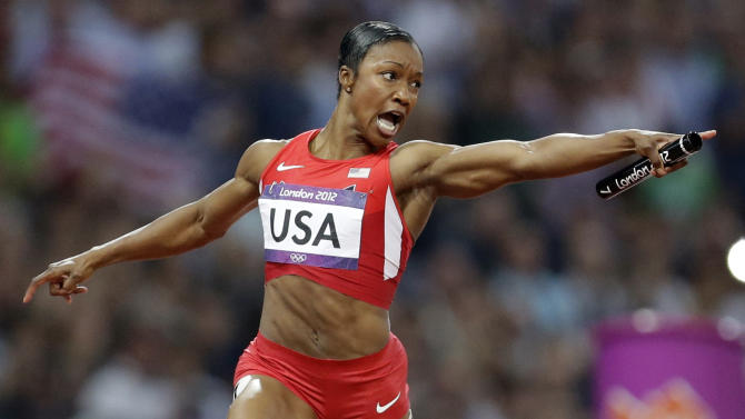 United States' Carmelita Jeter reacts as she crosses the finish line to win the women's 4 x 100-meter relay during the athletics in the Olympic Stadium at the 2012 Summer Olympics, London, Friday, Aug. 10, 2012. The United States relay team set a new world record with a time of 40.82 seconds.(AP Photo/Lee Jin-man)