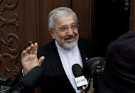 Iranian Ambassador to the International Atomic Energy Agency (IAEA) Ali Asghar Soltanieh arrives at the Iranian permanent mission in Vienna on May 14. Soltanieh on Saturday downplayed a report by the UN atomic watchdog that uranium traces have been detected of a higher grade than any found before, as local media voiced doubts about the next round of talks on Tehran's nuclear programme
