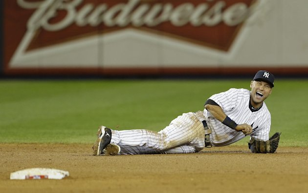 Oct. 14 New York Yankees shortstop Derek Jeter reacts after injuring himself in the 12th inning of Game 1 of the American League championship series against the Detroit Tigers early Sunday, Oct. 14, 2