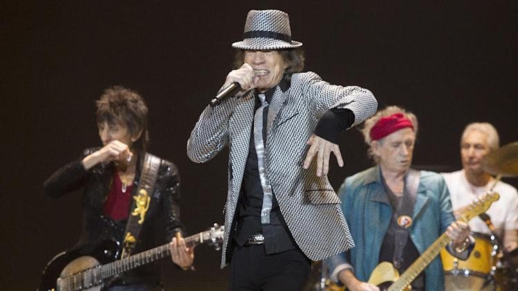 Mick Jagger, center, Keith Richards, Ronnie Wood, left, and Charlie Watts, right, of The Rolling Stones perform at the O2 arena in east London, Sunday, Nov. 25, 2012. The band are playing four shows to celebrate their 50th anniversary, including two shows at London's O2 and two more in New York. (Photo by Joel Ryan/Invision/AP)