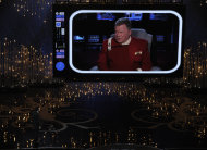 Host Seth MacFarlanem lower left, speaks to actor William Shatner, on screen, during the Oscars at the Dolby Theatre on Sunday Feb. 24, 2013, in Los Angeles. (Photo by Chris Pizzello/Invision/AP)