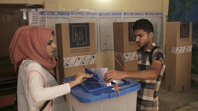 An Iraqi man casts his vote at a polling center in Baghdad, Iraq, Wednesday, April 30, 2014. A key election for a new Iraqi parliament was underway on Wednesday amid a massive security operation as the country continued to slide deeper into sectarian violence more than two years after U.S. forces left the country. (AP Photo/Khalid Mohammed)