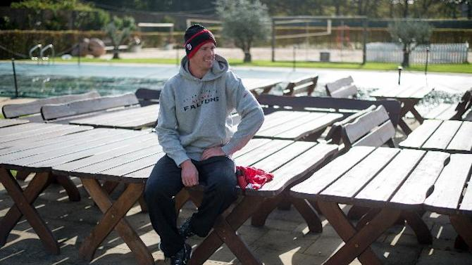 Atlanta Falcons quarterback Matt Ryan relaxes on a bench ahead of a press conference at The Grove Hotel in Watford England, Wednesday Oct. 22, 2014. The Falcons will play the Detroit Lions in an NFL football game at London's Wembley Stadium on Sunday, Oct. 26