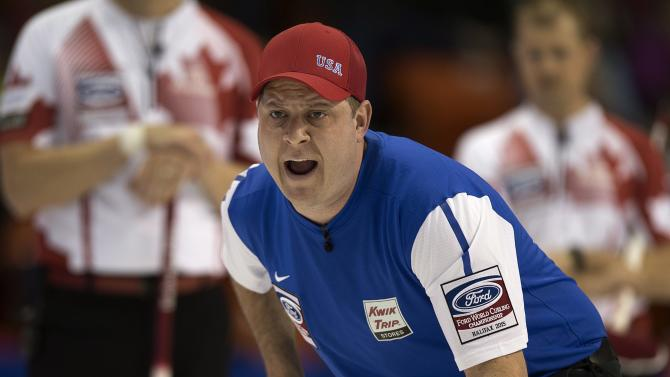 U.S. skip John Shuster calls the sweep during a match against Canada at the men's World Curling Championships in Halifax, Nova Scotia, on Saturday, March 28, 2015. (AP Photo/The Canadian Press, Andrew Vaughan)