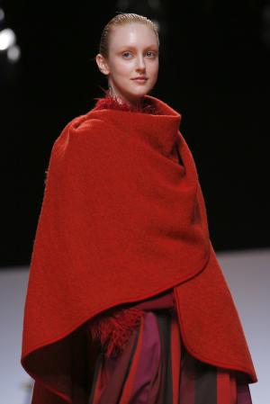 A model wears a creation for Issey Miyake's ready …