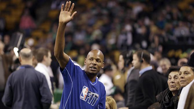 Miami Heat guard Ray Allen acknowledges people in the crowd during warmups before their NBA basketball game against the Boston Celtics at TD Garden in Boston, Sunday, Jan. 27, 2013. The Celtics won 100-98. (AP Photo/Steven Senne)