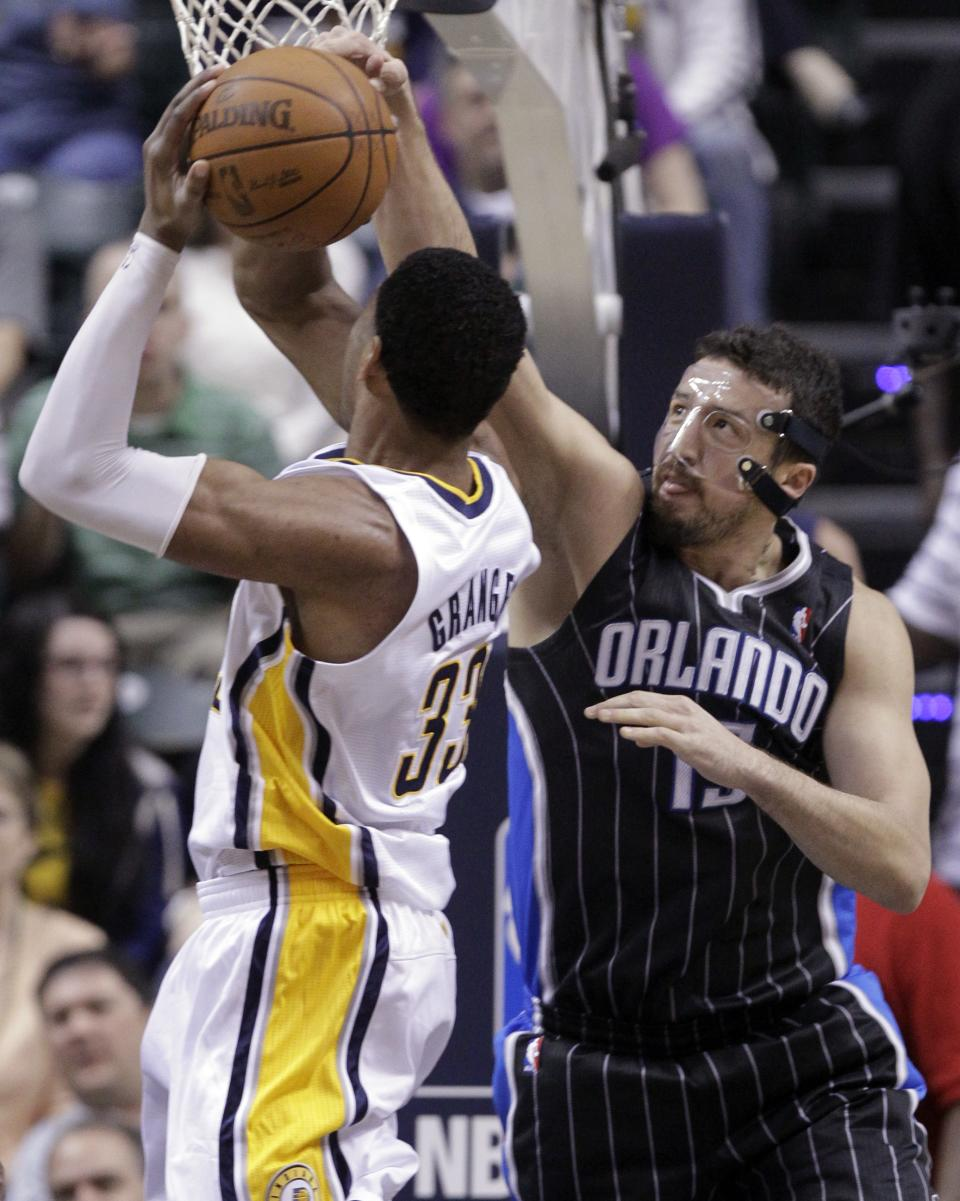 Orlando Magic forward Hedo Turkoglu, right, blocks the shot of Indiana Pacers forward Danny Granger during the first half of the second game of an NBA first-round playoff basketball series, in Indianapolis on Monday, April 30, 2012. (AP Photo/Michael Conroy)