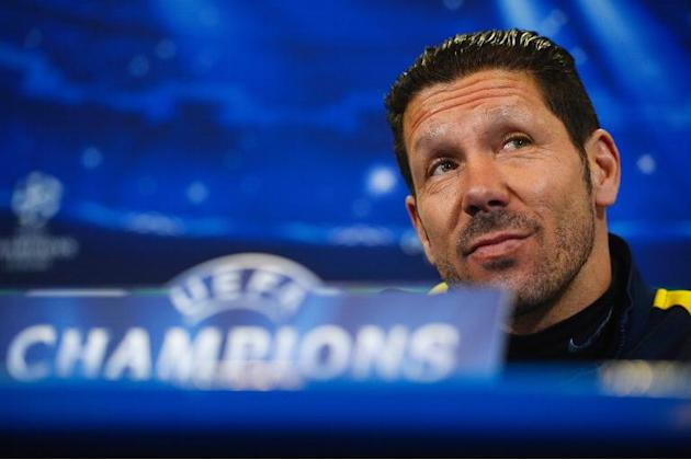 Atletico Madrid's Argentinian coach Diego Simeone listens during a press conference at the Vicente Calderon stadium in Madrid on March 10, 2014 on the eve of their Champions League football match