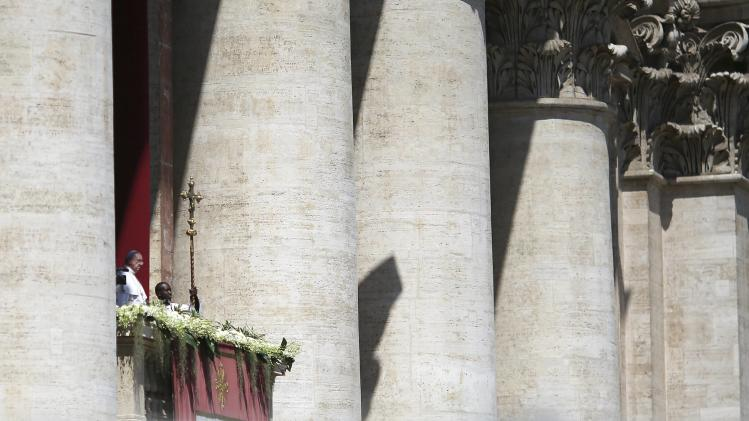 Pope Francis delivers the Urbi et Orbi (to the city and the world) benediction at the end of the Easter Mass in Saint Peter's Square at the Vatican