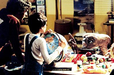 Michael ( Robert McNaughton ) and Elliott ( Henry Thomas ) try to get E.T. to tell him where he's from in Universal's E.T. The Extra-Terrestrial