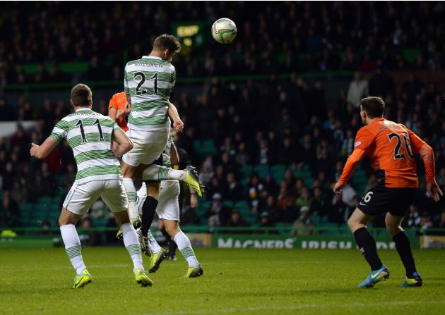 Celtic's Charlie Mulgrew scores against Dundee United with a header during their Scottish Premier League soccer match at Celtic Park, Glasgow, Scotland