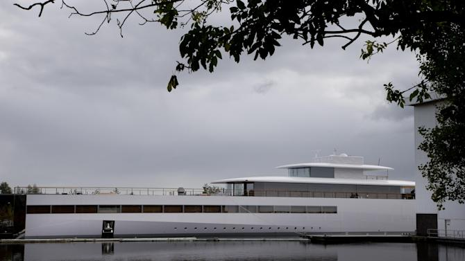 FILE - In this Tuesday Oct. 30, 2012 file photo, a yacht is docked at the wharf of ship building company Royal De Vries in Aalsmeer, near Amsterdam, Netherlands. The sleek, white superyacht Apple founder Steve Jobs commissioned before his death cannot leave the Netherlands just yet due to a payment dispute. Dutch newspaper Het Financieele Dagblad reported Friday Dec. 21, 2012 that Starck hired a debt collection agency and got a summary legal order to keep the boat from leaving. (AP Photo/Peter Dejong, file)