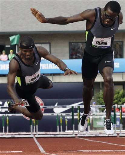 Kerron Clement lunges for the finish as Bershawn Jackson falls in the men's 400 meter hurdles final at the U.S. Olympic Track and Field Trials Sunday, July 1, 2012, in Eugene, Ore. (AP Photo/Eric Gay)