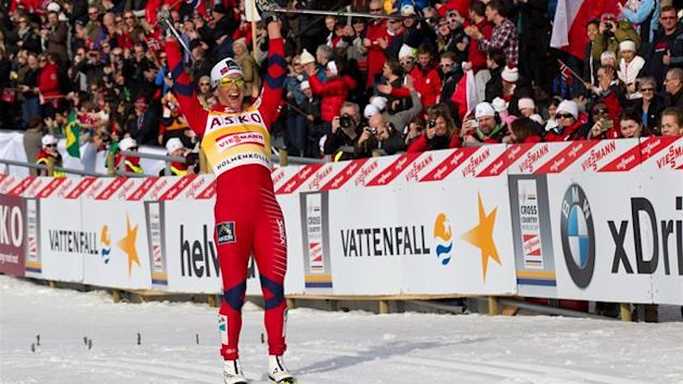Marit Bjoergen of Norway crosses the finish line to win the women's 30 km classic mass start at the FIS Cross-Country World Cup in Oslo