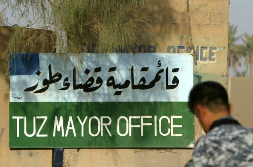 An Iraqi soldier guards the entrance to the Mayor's office in the town of Tuz Khurmatu