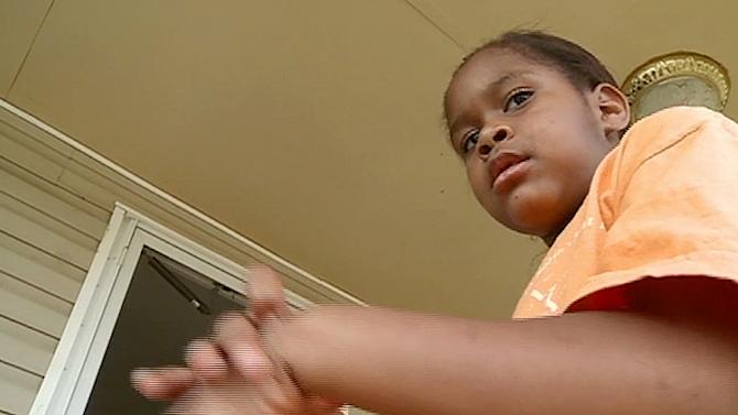 In this Monday, April 16, 2012 image made from video and provided by WMAZ-13 TV, kindergartner Salecia Johnson, 6, is shown at her home near Milledgeville, Ga. Police in Georgia handcuffed the kindergartner after the girl threw a tantrum, and the police chief is making no apologies.  Police in Georgia handcuffed the kindergartner after the girl threw a tantrum, and the police chief is making no apologies.  Johnson is accused of tearing items off the walls and throwing furniture at school in the central Georgia city of Milledgeville. The police report says the girl knocked over a shelf that injured the principal. (AP Photo/WMAZ-13 TV) MANDATORY CREDIT