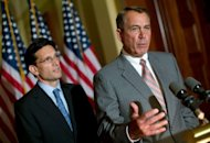 US Speaker of the House John Boehner (R) and House Majoirty Leader Eric Cantor (L) respond to US President Barack Obama's remarks on the US economy June 8, in Washington, DC. Republican have blasted Obama for blaming Europe for his own failings on the US economy