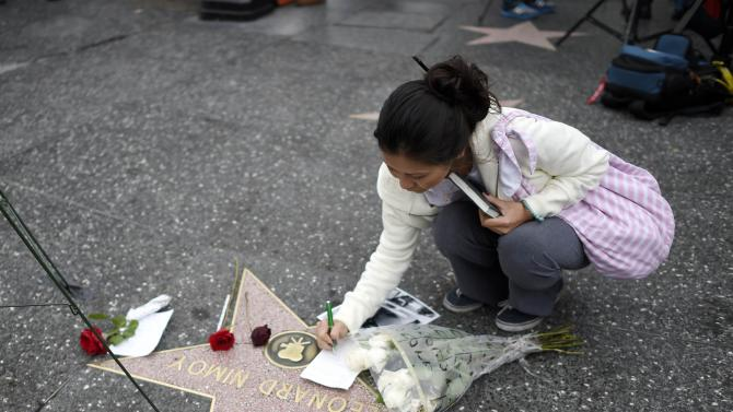 Christine Nguyen Chiem writes a note on the Hollywood Walk of Fame star of actor Leonard Nimoy on Hollywood Boulevard in Los Angeles
