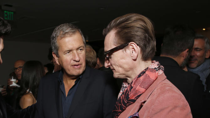 Mario Testino and Hamish Bowles celebrate the Peruvian native's Fashion Icon Exhibit with cocktails by Porton at Prism on Saturday February 23, 2013 in Los Angeles. (Photo by Todd Williamson/Invision for Porton/AP)