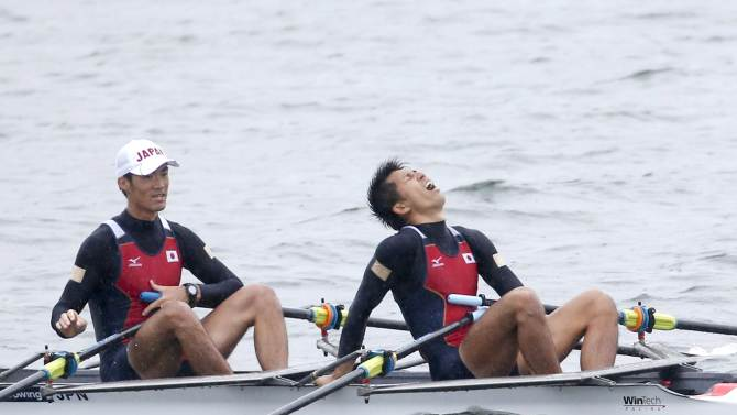 Japan's Suda and Omoto react after winning the final of the men's lightweight Men's double sculls of the rowing competition at the Chungju Tangeum Lake International Rowing Center, during the 17th Asian Games in Incheon