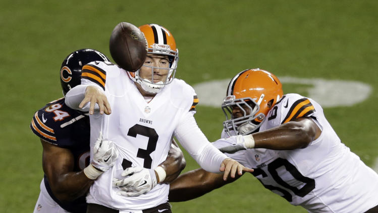 Browns make cuts, Grossman kept as third QB