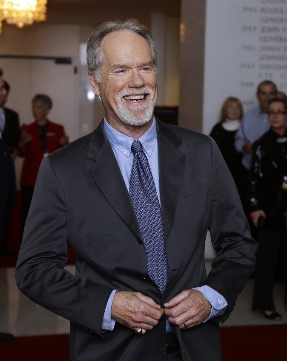 Musician Loudon Wainwright III, poses for photographers on the red carpet before entertainer Ellen DeGeneres receives the 15th annual Mark Twain Prize for American Humor at the Kennedy Center, Monday, Oct. 22, 2012, in Washington. (AP Photo/Alex Brandon)