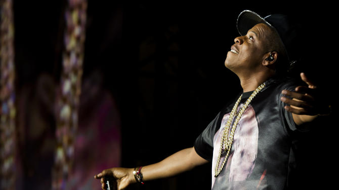 """Jay-Z performs at the """"Made In America"""" music festival on Saturday, Sept. 1, 2012, in Philadelphia, PA. (Photo by Charles Sykes/Invision/AP)"""