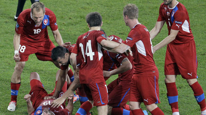 Czech Republic's Petr Jiracek, left, is celebrated by teammates after scoring the opening goal during the Euro 2012 soccer championship Group A match between Czech Republic and Poland in Wroclaw, Poland, Saturday, June 16, 2012. (AP Photo/Antonio Calanni)