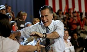 Mitt Romney greets supporters as he takes the stage for a campaign event at the Red Rocks Amphitheatre on Oct. 23 in Golden, Colo.