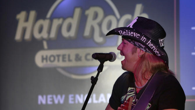IMAGE DISTRIBUTED FOR HARD ROCK INTERNATIONAL - Bret Michaels, rocks out for a VIP audience at the announcement event for Hard Rock International's application submission for Hard Rock Hotel & Casino New England at Eastern States Exposition in West Springfield, Mass., on Friday, Jan. 11, 2013. (Photo by Bizuayehu Tesfaye/Invision for Hard Rock International/AP Images)