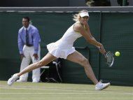 Maria Sharapova of Russia returns a shot to Su-Wei Hsieh of Taiwan during a third round women's singles match at the All England Lawn Tennis Championships at Wimbledon, England, Friday, June 29, 2012. (AP Photo/Anja Niedringhaus)