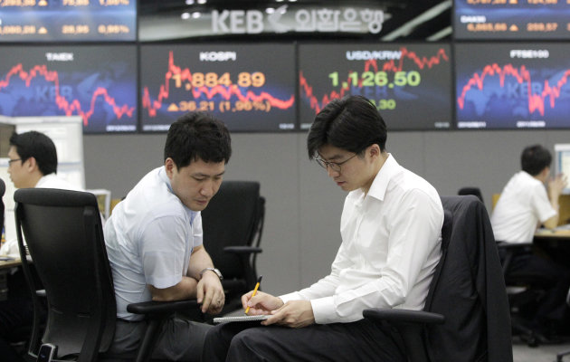 Currency traders work at the foreign exchange dealing room of the Korea Exchange Bank headquarters in Seoul, South Korea, Monday, Aug. 6, 2012. The Korea Composite Stock Price Index rose 2.01 percent, or 37.20, to close at 1,885.88. (AP Photo/Ahn Young-joon)
