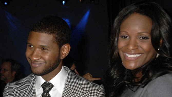 FILE - n this Sept. 25, 2007 file photo, Grammy award winner Usher Raymond and wife his Tameka Foster mingle at a party for the unveiling of Usher's new fragrances, Usher for Men and Usher for Women, in New York. It's been more than a year since the son of Usher's ex-wife Tameka Raymond died in a boating accident on a Georgia lake. Yet Raymond is keeping the memory of her son Kile Glover alive, honoring him with the first Give Thanks 5K run/walk Saturday morning at Chastain Park in Atlanta. She wants to raise money for the Kile's World Foundation's art initiatives and upcoming camps. (AP Photo/John Smock, file)