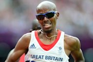 Britain&#39;s Mo Farah competes in the men&#39;s 5000m heats at the athletics event of the London 2012 Olympic Games. Farah remained on course for a distance double after safely negotiating his passage into the final of the 5000m